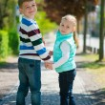 Two happy children walking in park — Stock Photo #75937651