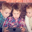 Three little children playing with tablet pc — Stock Photo #76183891