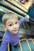 Cute little boy on escalator — Stock Photo