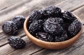 Prunes on a wooden background — Stock Photo