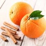 Orange fruit with cinnamon sticks — Stock Photo #65629093