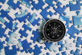 Compass and puzzle — Stock Photo