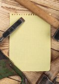 Carpentry tools and a piece of notebook — Stock Photo