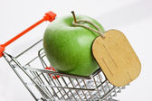 Apple with tag — Stock Photo