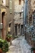 Narrow cobbled street — Stock Photo
