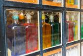 Botellas con líquido coloreado — Foto de Stock