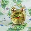 Alarm clock on Euro banknotes — Stockfoto #60534881