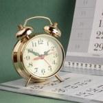 Alarm clock and calendar — Stock Photo #60535269