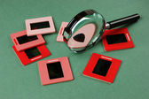 Old slides and magnifying glass — Foto de Stock