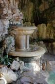 Small fountain in a stone niche — Stock Photo
