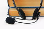 Headphones with stack of books — Stock Photo