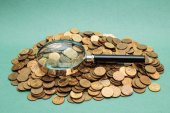 Magnifying glass on coins — Stock Photo