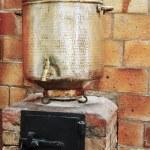 Big old copper samovar — Stock Photo #67583091