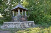 Heritage village, rustic wooden well — Stock Photo