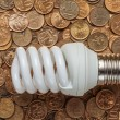Light bulb with coins — Stock Photo #74774685