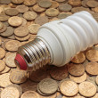 Light bulb with coins — Stock Photo #74774727