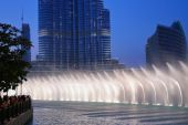Dancing fountains in lake — Stock Photo