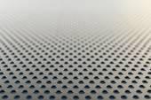 Metallic background with round holes — Stock Photo