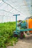 Big pesticide sprayer in greenhouse — Stock Photo