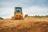 Bulldozer on sand — Stockfoto