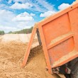 Tipper unloading sand — Stock Photo #53016693