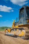 Bulldozer on sand — Stock Photo