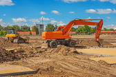 Excavator on construction site — Stock Photo