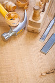Chisel hammer woodworkers plane on wooden board — Stock Photo