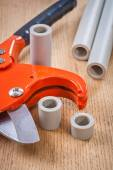 Pipe cutter and cutted pipes — Stock Photo