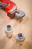 Plumbing fixtures and monkey wrench — Stock Photo