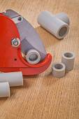 Pipe cutter with cutted pipes — Stock Photo