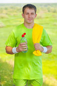 Young men wearing sports clothes with yellow cotton towel holdin — Stock Photo