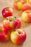 Smal stack of apples on wooden boards — Stock Photo