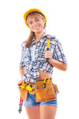 Beautiful female construction worker holding claw hammer and oth — Stock Photo