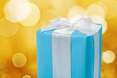 Classical blue gift box with white ribbon and bow — Stock Photo