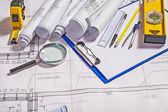 Set of architect tools on white blueprint — Stock Photo