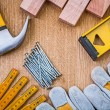 Set of tools claw hammer stack of nails safety gloves constructi — Stock Photo #57655153