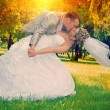 Wedding couple kissing in the park at sunset instagram stile — Stock Photo #57655899