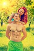 Happy young sporty couple in park instagram stile — Foto de Stock