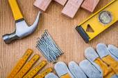 Set of tools claw hammer stack of nails safety gloves constructi — Stock Photo