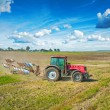 Agriculture processing tractor with plow — Stock Photo #58691843