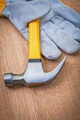 Claw hammer and protective glove — Stock Photo