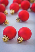 Small red christmas baubles — Stock Photo
