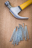 Stack of nails and claw hammer — Stock Photo