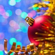 Red bauble and tinsel — Stock Photo #58756701