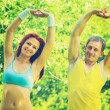 Sportsman and sportswoman exercising in park — Stock Photo #58756729