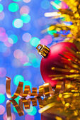 Red bauble and tinsel — Stock Photo