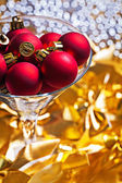 Red christmas balls in wineglass — Stock Photo