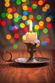 Vintage candle in candleholder — Stock Photo