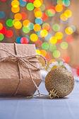 Paper giftbox and christmas ball — Stock Photo